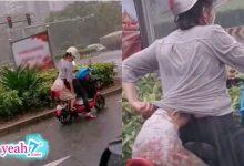 Photo of Gặp mưa lớn, người mẹ cố gắng che chắn cho con mặc bản thân bị ướt