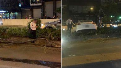 Photo of Vụ xe sang Porsche cày nát dải phân cách ở Hà Nội: Xuất hiện hình ảnh nghi là tài xế đứng cạnh xe bấm điện thoại, không có chuyện đột quỵ?